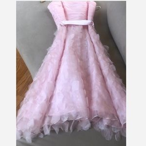 A beautiful pink dress,  in pristine condition.